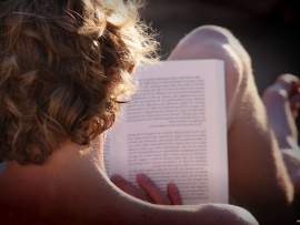 young_man_reading_book-t2